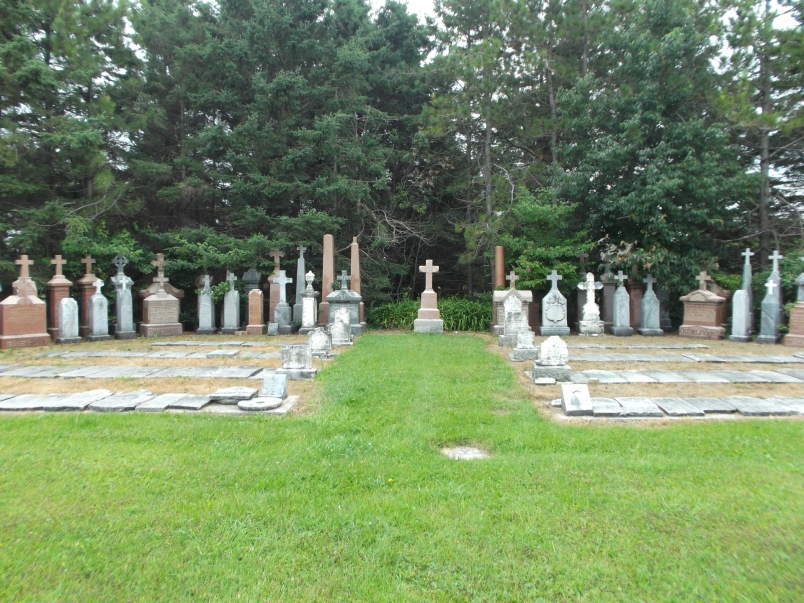 Picture of the tombstones spread out in the shape of angel wings.