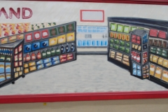 Part of the mural on side of Foodland showing the inside of a grocery store.